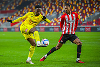 Football - 2020 / 2021 Sky Bet (EFL) Championship - Brentford vs. Wycombe Wanderers  - Brentford Community Stadium<br /> <br /> Jack Grimmer (Wycombe Wanderers) watched by Ethan Pinnock (Brentford  FC) as he attempts to cross <br /> <br /> COLORSPORT/DANIEL BEARHAM