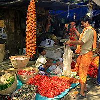 Asia, India, Calcutta. Shopping at the flower market in Calcutta.
