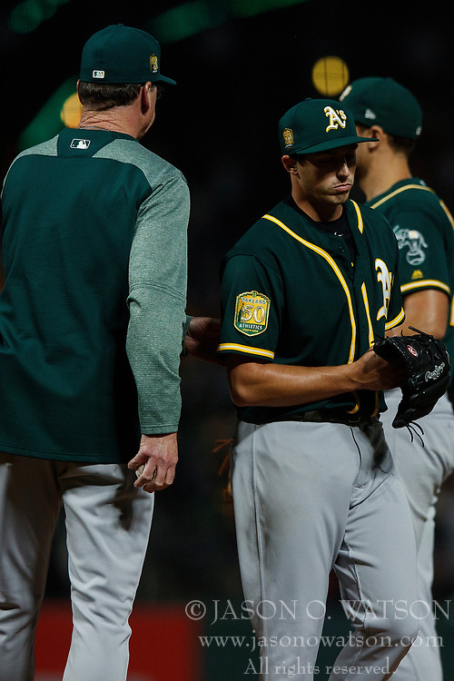 SAN FRANCISCO, CA - JULY 13: Ryan Dull #66 of the Oakland Athletics is relieved by manager Bob Melvin #6 during the seventh inning against the San Francisco Giants at AT&T Park on July 13, 2018 in San Francisco, California. The San Francisco Giants defeated the Oakland Athletics 7-1. (Photo by Jason O. Watson/Getty Images) *** Local Caption *** Ryan Dull; Bob Melvin