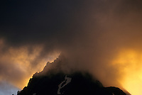 A veil of clouds obscures a peak at sunset in North Cascades National Park, Washington.