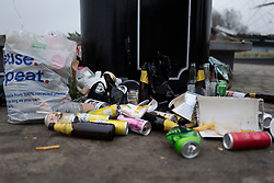 © Licensed to London News Pictures. 01/04/2021. London, UK. An overflowing bin in Cutty Sark Gardens after large groups of people visited to enjoy the warm weather and take advantage of new lockdown rules that allow groups of six to meet outside. Photo credit: George Cracknell Wright/LNP