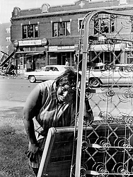 December 28, 1967 - Michigan, U.S. - The flames of riot leave so little for their victims. For Emma Jean Woolford it was only bedsprings and a headboard dragged desperately from her blazing home to safety at Boston Blvd snd Linwood in Detroit on Sunday, July 23, 1967. (Credit Image: © Detroit Free Press via ZUMA Wire)