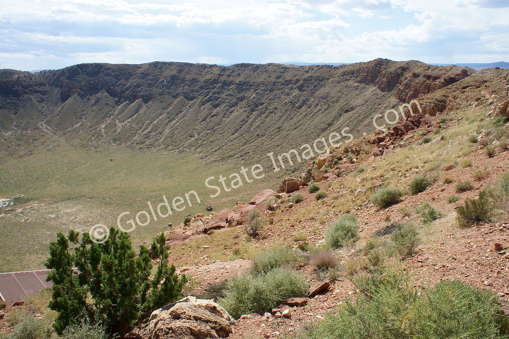 Billed as the most well known best preserved meteorite crater on earth. <br /> <br /> Formed when a piece of an Asteroid slammed into the earth at some 26,000 miles per hour.<br /> The impact occurred some 50,000 years ago during the Pleistocene epoch.<br /> <br /> Forming a crater 2.4 miles in circumference and more than 500 feet deep, its estimated the collison released the explosive force of some 20 million tons of TNT.<br /> <br /> The rim of the crater rises 150 feet above the surrounding desert plains.<br /> <br /> It would have been a bad day for the Woolly Mammoths that inhabited what was grasslands at the time.