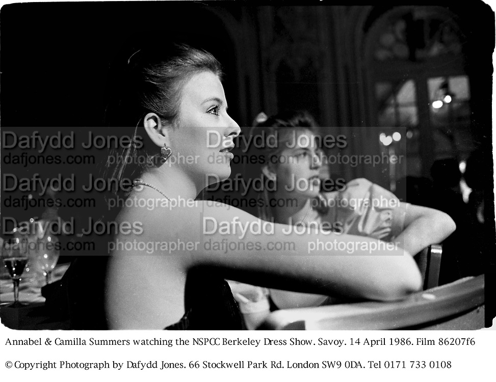 Annabel & Camilla Summers watching the NSPCC Berkeley Dress Show. Savoy. 14 April 1986. Film 86207f6<br />