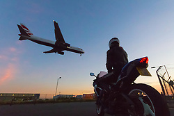 London Heathrow, September 19th 2015. A Biker watches planes land at London Heathrow.
