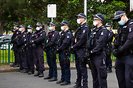 Specialist public order police stand guard outside of the 120 Racecourse Road housing complex amid the third full day of the total lockdown of 9 housing commission high rise towers in North Melbourne and Flemington during COVID 19.After recording 191 COVID-19 cases overnight forcing Premier Daniel Andrews to announce today that all of metropolitan Melbourne along with one regional centre, Mitchell Shire will once more go back to stage three lockdowns from midnight Wednesday June 8. This comes as the residents of the housing commission towers in North Melbourne and Flemington finish their third day under extreme lockdown, despite only 27 cases being found in the towers. Members of the public gathered outside of the towers this afternoon in support of those trapped inside while riot police arrested two women for standing too close to the fence. While the women were later released, tensions are boiling over both in the towers and out. With 772 active cases in Victoria, NSW closed their border to Victoria effective at midnight tonight.