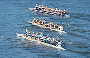 London, United Kingdom. No 79 top. Basler Ruderclub [SUI] No 80. middle Putney town RC B crew and  No. 81, Upper Thames RC. B Crew. in a close race,  from Barnes Rail Bridge. 2014 Women's Head of the River Race. Chiswick to Putney, River Thames.  Saturday  15/03/2014    [Mandatory Credit; Peter Spurrier/Intersport-images]