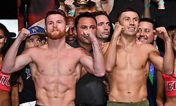 Sept 15,2017. Las Vegas, NV. (L-R)  Canelo Alvarez poses off with GGG during the weighs in's  at the MGM grand hotel Friday.  Canelo Alvarez will be fighting GGG Saturday at the T-Mobile arena for the WBC,WBA,IBF,IBO ring middleweight titles..Photo by Gene Blevins/LA DailyNews/SCNG/ZumaPress. (Credit Image: © Gene Blevins via ZUMA Wire)