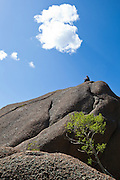 Marco Binotti sits on top of a large boulder in the Lost Creek Wilderness, Colorado.