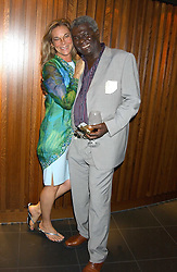 BASIL CHARLES and close friend DIANNE WILSON at a party to celebrate the OBE for Basil Charles - The famous Mustique bar owner held at Pengelley's, Sloane Street, London on 22nd June 2005.<br /><br />NON EXCLUSIVE - WORLD RIGHTS