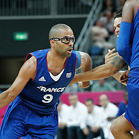 29 July 2012: Tony Parker of France drives by USA Deron Williams on a screen by Ronny Turiaf during the 98-71 Team USA victory over Team France, during the men's basketball preliminary, at the Basketball Arena, in London, Great Britain.