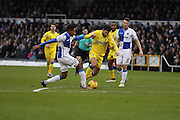 AFC Wimbledon defender George Francomb (7) battles for possession with Bristol Rovers striker Christian Montano (21) during the EFL Sky Bet League 1 match between Bristol Rovers and AFC Wimbledon at the Memorial Stadium, Bristol, England on 31 December 2016. Photo by Stuart Butcher.