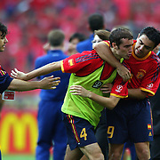 Spain's Ivan Helguera is restrained by team mate Morientes after a confrontation with the linesman after the penalty shoot out