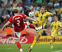 Photo: Chris Ratcliffe.<br /> Switzerland v Ukraine. 2nd Round, FIFA World Cup 2006. 26/06/2006.<br /> Andriy Voronin of Ukraine clashes with Ludovic Magnin of Switzerland.