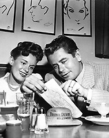 1957 Glenn Ford and Virginia McPherson at The Brown Derby on Vine St.