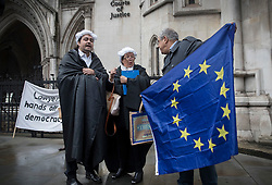 © Licensed to London News Pictures. 13/10/2016. London, UK. Pro and anti EU referendum result protestors argue outside the High Court. A legal challenge is being launched, after the EU referendum result, to force the government to seek Parliamentary approval before Brexit negotiations begin. Photo credit: Peter Macdiarmid/LNP