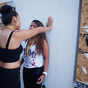 A crying young woman gets a telling off by another woman in Portobello Road. The Notting Hill Carnival has been running since 1966 and is every year attended by up to a million people. The carnival is a mix of amazing dance parades and street parties with a distinct Caribbean feel.