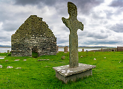 Exterior view of Kilnave Chapel and Cross beside west  Loch Gruinart,  Islay, Argyll & Bute, Inner Hebrides, Scotland