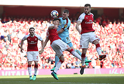 Burnley's Sam Vokes (centre right) and Arsenal's Konstantinos Mavropanos (centre left) battle for the ball during the Premier League match at the Emirates Stadium, London.