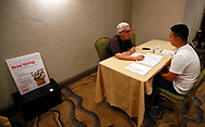 A recruiter for Subway talks with an applicant a job fair in Golden, Colorado June 7, 2016. REUTERS/Rick Wilking