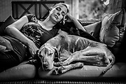 SHOT 8/5/18 3:16:40 PM - Tanner, a 13 year-old male Vizsla, naps with his mom Margaret Ebeling of Madison, Wis. at Tanner's home in Denver, Co. Vizslas are natural hunters endowed with an excellent nose and an outstanding trainability. Although they are lively, gentle-mannered, demonstrably affectionate and sensitive, they are also fearless and posses a well-developed protective instinct. (Photo by Marc Piscotty / © 2018)