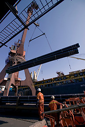 Tianjin, China,exporting, dock workers, Chinese, shipping, port, trucks, export, industrial, shipping steel pipe,