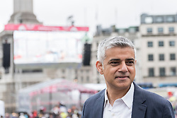 © Licensed to London News Pictures. 12/06/2016. London, UK.  Sadiq Khan, recently elected Mayor of London, greets large numbers of people gathered in Trafalgar Square, despite heavy rain, for the Mayor of London's Patrons Lunch in celebration of The Queen's official 90th birthday. Photo credit : Stephen Chung/LNP