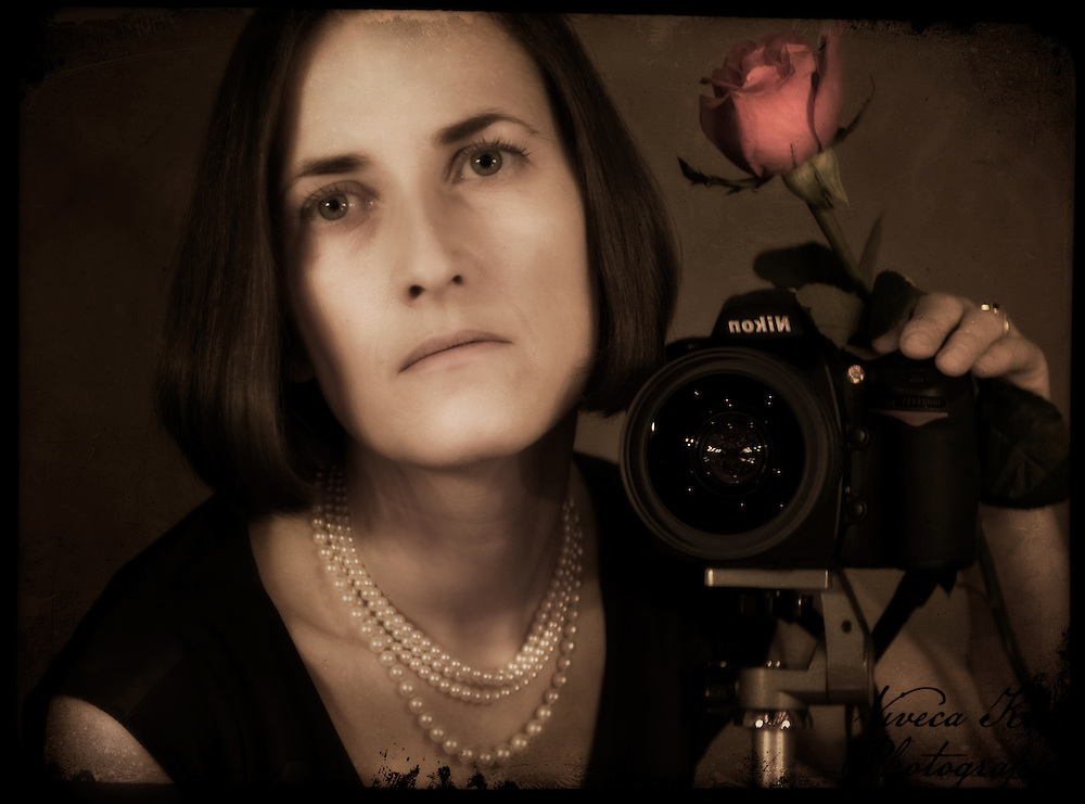 Self portrait with camera and red rose.
