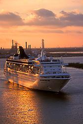 Cruise liner departing at sunset