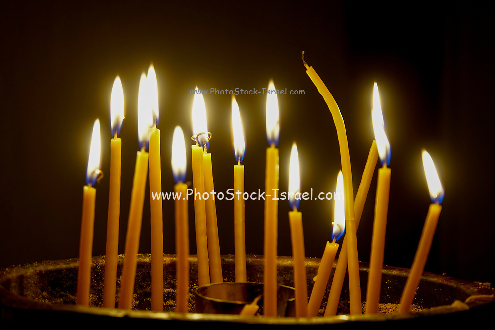 Lit candles in a Catholic Church. Photographed in Crete, GREECE