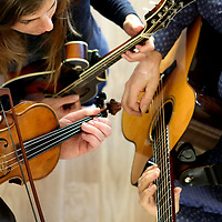 Edwin Huizinga on violin, Ashley Broder on Mandolin and William Coulter on guitar, practice in Bonny Doon, California on June 5, 2018 for their June 8 concert. The virtuoso musicians perform as Fire & Grace & Ash and play a wide array of music including fresh arrangements of Bach, Celtic, Vivaldi, American and World Music.<br /> Photo by Shmuel Thaler <br /> shmuel_thaler@yahoo.com www.shmuelthaler.com