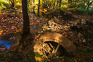 A part of watermill by thhe river in the forest