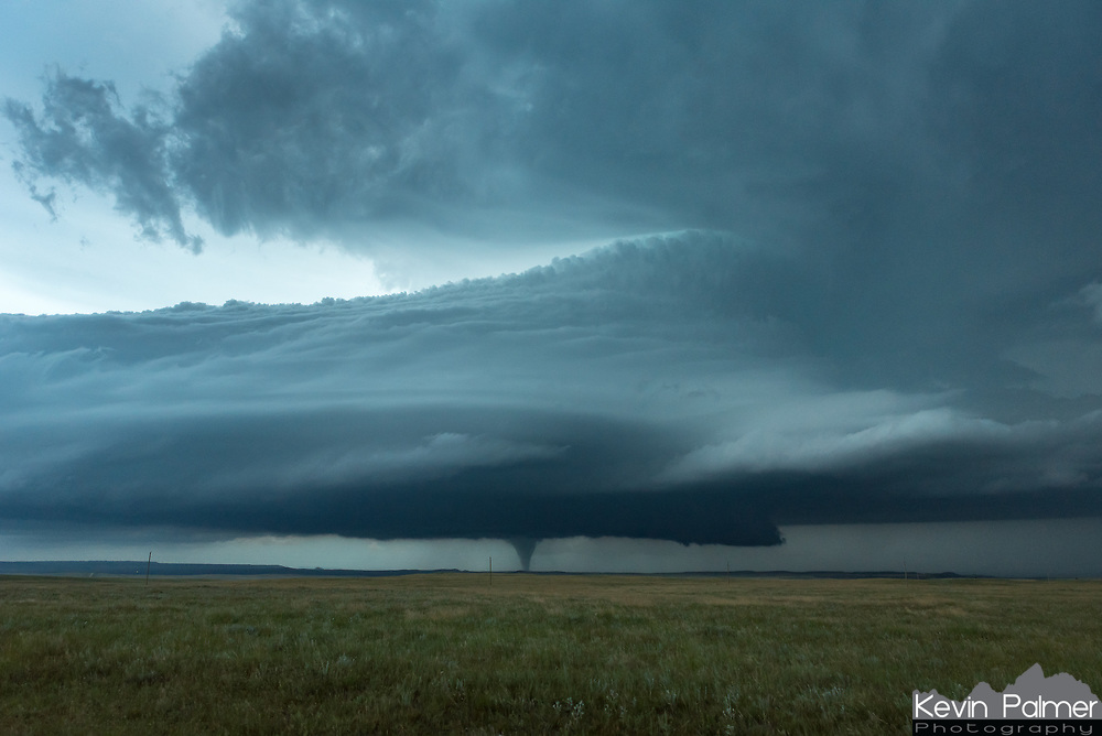 This was a day I won't soon forget. The forecast called for very humid air, extreme instability, and strong wind shear in the MT/ND/SD area. Having all these conditions come together at the same time is quite rare and I knew something incredible would happen. I just had to be there. The day involved lots of waiting around in eastern Montana until I set my sights on this supercell in the late evening. The storm structure was otherworldly, looking like a tsunami in the sky. When the first tornado dropped there were hills in the way and road options to get closer were limited. But outside of Buffalo, South Dakota, finally the twister became visible. The tornado lifted and planted again about 4 times. It was looking the best as the sun was setting at 9pm. I was never closer than about 9 miles, but this gave me the advantage of seeing more of the storm's structure. Now I finally have a tornado clip to finish up my time lapse film.