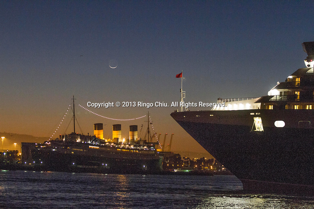 The Queen Elizabeth (R), the ocean liner cruises into Long Beach Harbor to rendezvous and pay tribute to her predecessor the Queen Mary (L) on Tuesday, March 12, 2013 in Long Beach, California. The world famous former Cunard liner R.M.S. Queen Mary, once the undisputed Grand Dame of the North Atlantic and perhaps the most loved ocean liner of the 20th century, visited by the youngest Cunarder Queen Elizabeth. (Photo by Ringo Chiu/PHOTOFORMULA.com).