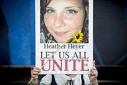 August 27, 2017 - Tokyo, Tokyo, Japan - A participant holds a photo of Heather Heyer during the standing silent appeal, a hundred people gathered in shibuya against racism and violence in memory of Heather Heyer under the slogan ''Let us all unite'' In Tokyo August 27, 2017. Heather Heyer died on August 12, 2017 when a car rammed into a group of people protesting against a white supremacist rally in Charlottesville, Virginia. (Credit Image: © Alessandro Di Ciommo/NurPhoto via ZUMA Press)