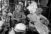 MONOCHROME<br /> Two elderly ladies at their market stall.<br /> Vung Tau, Vietnam
