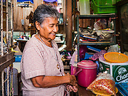 27 AUGUST 2016 - BANGKOK, THAILAND: A resident of the Pom Mahakan slum sells bird seed in her home. The Pom Mahakan community is known for fireworks, fighting cocks and bird cages. Mahakan Fort was built in 1783 during the reign of Siamese King Rama I. It was one of 14 fortresses designed to protect Bangkok from foreign invaders. Only two of the forts are still standing, the others have been torn down. A community developed in the fort when people started building houses and moving into it during the reign of King Rama V (1868-1910). The land was expropriated by Bangkok city government in 1992, but the people living in the fort refused to move. In 2004 courts ruled against the residents and said the city could evict them. The city vowed to start the evictions on Sept 3, 2016, but this week Thai Prime Minister Gen. Prayuth Chan-O-Cha, sided with the residents of the fort and said they should be allowed to stay. Residents are hopeful that the city will accede to the wishes of the Prime Minister and let them stay.       PHOTO BY JACK KURTZ