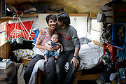 Eli Shanks '18 poses for a portrait with his wife Andrea and his son Rafael in his modified police bus, which Shanks turned into their home, in Trumansburg, New York on September 17, 2017.<br /> <br /> Credit: Cameron Pollack / The Cornell Daily Sun