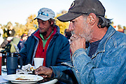 "Jan 10, 2010 - PHOENIX, AZ: RALPH, a homeless man in Phoenix, eats breakfast with his friends at CrossRoads United Methodist Church in Phoenix, AZ. City zoning officials have ordered the church to stop serving breakfast to the homeless and indigent on Saturday mornings. The church started serving breakfast to the homeless in Jan. 2009 and shortly after that neighbors in the upscale area of Phoenix complained to city officials that the church was in violation of zoning ordinances. The city found the church was operating a ""charity kitchen"" and ordered them to stop serving the breakfast. Rev. Dottie Escobedo-Frank, the pastor of the church, has said the church will file an appeal in US District Court and continue serving the breakfast until the appeals process is exhausted. About 150 people attend the Saturday breakfast each week. Some walk to the church from the alleys they live in in the neighborhood, others are bused to the breakfast by the church, which sens a bus in 1.5 mile radius from the church.         Photo by Jack Kurtz"