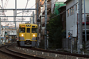 A Seibu 2000 series train (First batch type) on the Seibu Ikebukuro Line  near Shimo Ochiai, Tokyo, Japan January 8th 2015