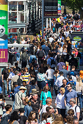 Thousands of tourists and Londoners pack the Queen's Walk near the London Eye, enjoying the sunshine and attractions. London, May 09 2018.