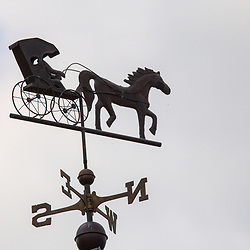 A weathervane using an Amish buggy for wind direction.