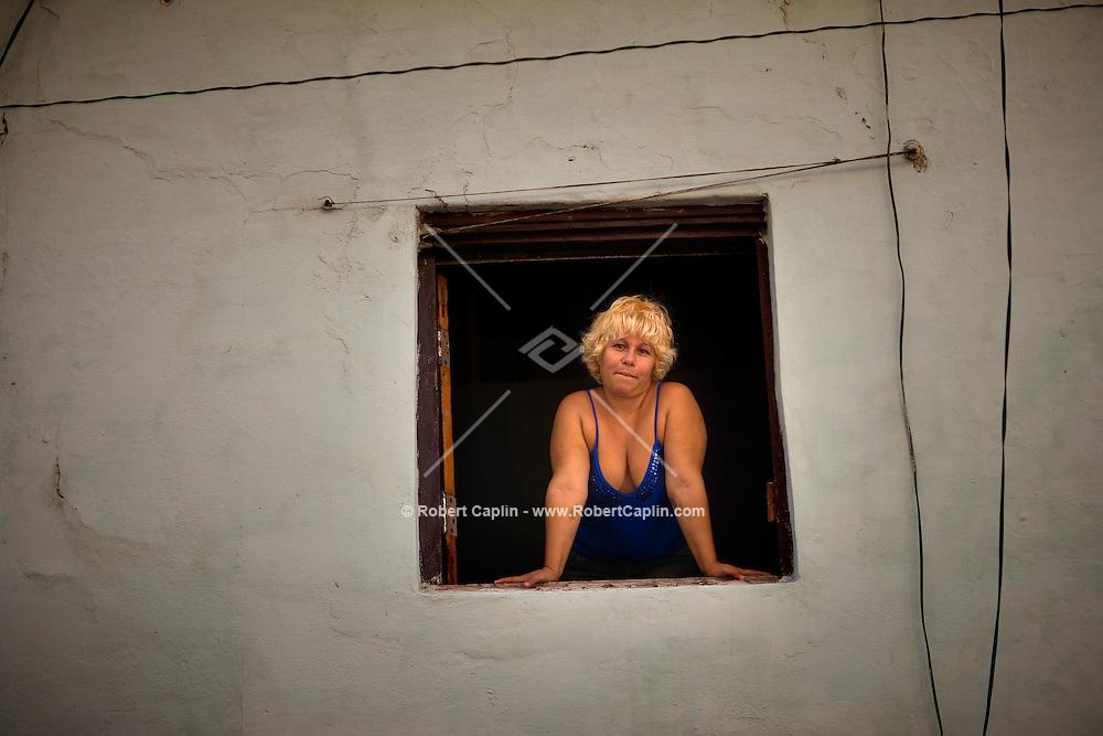 portrait of cuban woman in window
