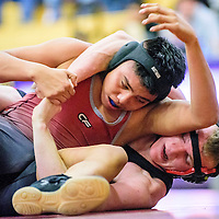 012815  Adron Gardner/Independent<br /> <br /> Shiprock Chieftain Jordan Ashley, left,  and Grants Spencer Steffenson tie up during a wrestling match at Miyamura High School in Gallup Wednesday.