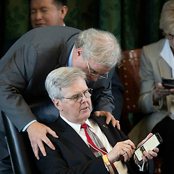 Texas Senate action on Monday, May 17, 2021 showing Sen. Paul Bettencourt talking with Lt. Gov. Dan Patrick