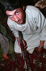 A servant holding an AK-47 at the Kandahar's Governor house