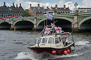 Flotilla of Ffshermen and campaigners for the 'Leave' campaign demonstrate in boats outside the Houses of Parliament in London, The Brexit battle took to London's River Thames as boats supporting the 'Leave' and 'Remain' campaigns jostled for space, while Bob Geldof harangued U.K. Independence Party leader Nigel Farage using a sound system. 15 June 2016