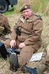 A reenactor portrays a uniformed war correspondent with portable Typewriter at the Spam Wartime Weekend Heckmondwike<br /> 10th July 2011<br /> Images © Paul David Drabble