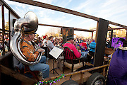 A band performs on a float during the fifth-annual Oak Cliff Mardi Gras Parade on Sunday, February 10, 2013 in Dallas, Texas. (Cooper Neill/The Dallas Morning News)