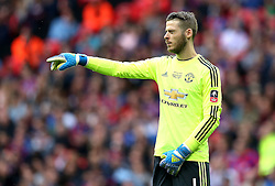 David De Gea of Manchester United points to his defenders with his eyes closed - Mandatory by-line: Robbie Stephenson/JMP - 21/05/2016 - FOOTBALL - Wembley Stadium - London, England - Crystal Palace v Manchester United - The Emirates FA Cup Final
